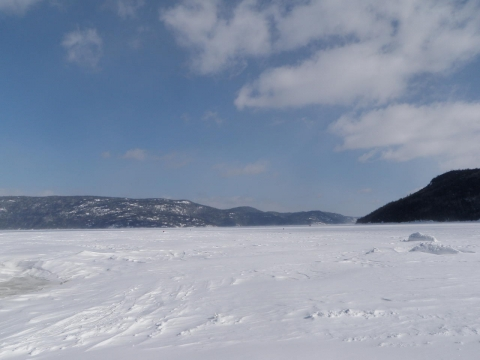 Snowmobile on the Saguenay Fjord, in front off Cap au Leste outfitter