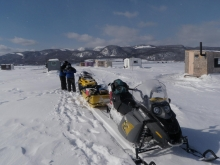 fishing village shack, snowmobile on the Saguenay Fjord